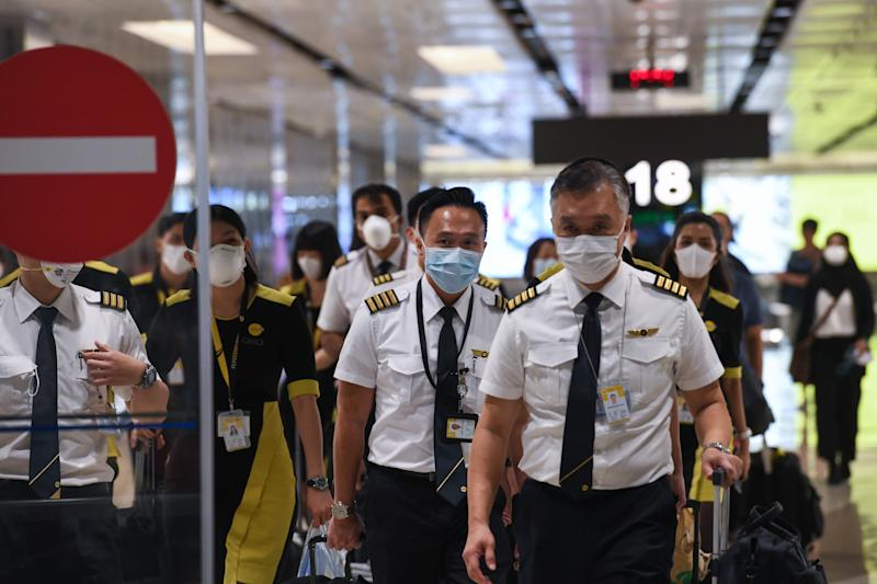 The flight crew of the chartered Scoot airline which flew to Wuhan to evacuate Singaporean nationals arrive at Changi international airport on Singapore on 30 January, 2020. (PHOTO: AFP via Getty Images)