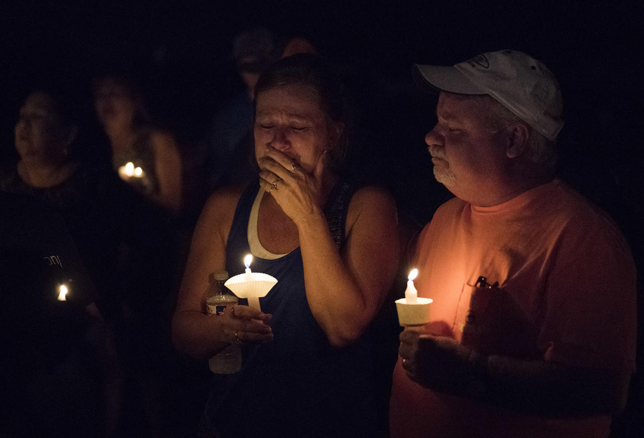 <p>Mourners participate in a candlelight vigil for the victims of a fatal shooting at the First Baptist Church of Sutherland Springs, Nov. 5, 2017, in Sutherland Springs, Texas. (Darren Abate/AP) </p>