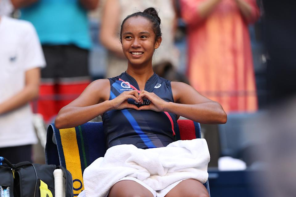 Leylah Fernandez smiles and gestures from the bench after defeating Elina Svitolina in the US Open.
