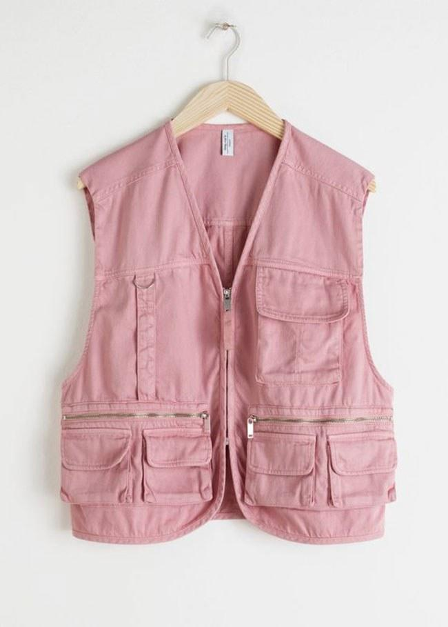 """Pretty (and practical) in pink. $129, & Other Stories. <a href=""""https://www.stories.com/en_usd/clothing/jackets-coats/jackets/product.cotton-blend-workwear-vest-pink.0760674001.html"""">Get it now!</a>"""
