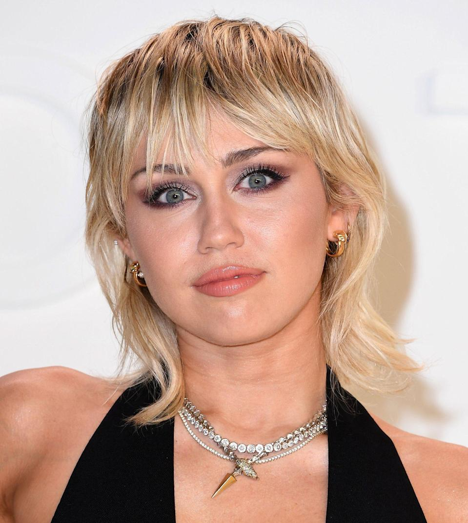 """<p>This has been a celebrity-favorite hair trend all of 2021 — just look at <a href=""""https://www.instyle.com/celebrity/miley-cyrus/miley-cyrus-new-hair-saturday-night-live"""" rel=""""nofollow noopener"""" target=""""_blank"""" data-ylk=""""slk:Miley Cyrus"""" class=""""link rapid-noclick-resp"""">Miley Cyrus</a> and<a href=""""https://www.instyle.com/news/billie-eilish-bob-straight-bangs"""" rel=""""nofollow noopener"""" target=""""_blank"""" data-ylk=""""slk:Billie Eilish"""" class=""""link rapid-noclick-resp""""> Billie Eilish</a>. Jagged and shaggy layers will give you that rock and roll vibe that will perfectly compliment every party look this summer. For a specific cut like this, Bergamy suggests taking a photo to your hairstylist. """"The stylist then can see if this specific style goes with your face shape [and] can create a variation of the style to best suit you,"""" she says.</p>"""