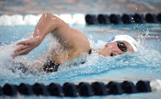 Katie Ledecky swims in the women's 800-meter freestyle at the U.S. national championships, Wednesday, Aug. 6, 2014, in Irvine, Calif. Ledecky won the race. (AP Photo/Mark J. Terrill)