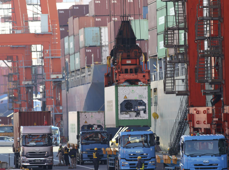 A cargo is unloaded from a truck to load onto a freighter at a port in Tokyo, Monday, Jan 27, 2014. Japan's trade deficit surged to a record 11.47 trillion yen ($112 billion) in 2013 as the shutdown of nuclear power plants swelled the nation's energy import bill. Provisional data Monday showed that exports rose 9.5 percent to 69.8 trillion yen ($680.9 billion), while imports jumped 15 percent to 81.3 trillion yen ($793.2 billion). (AP Photo/Koji Sasahara)