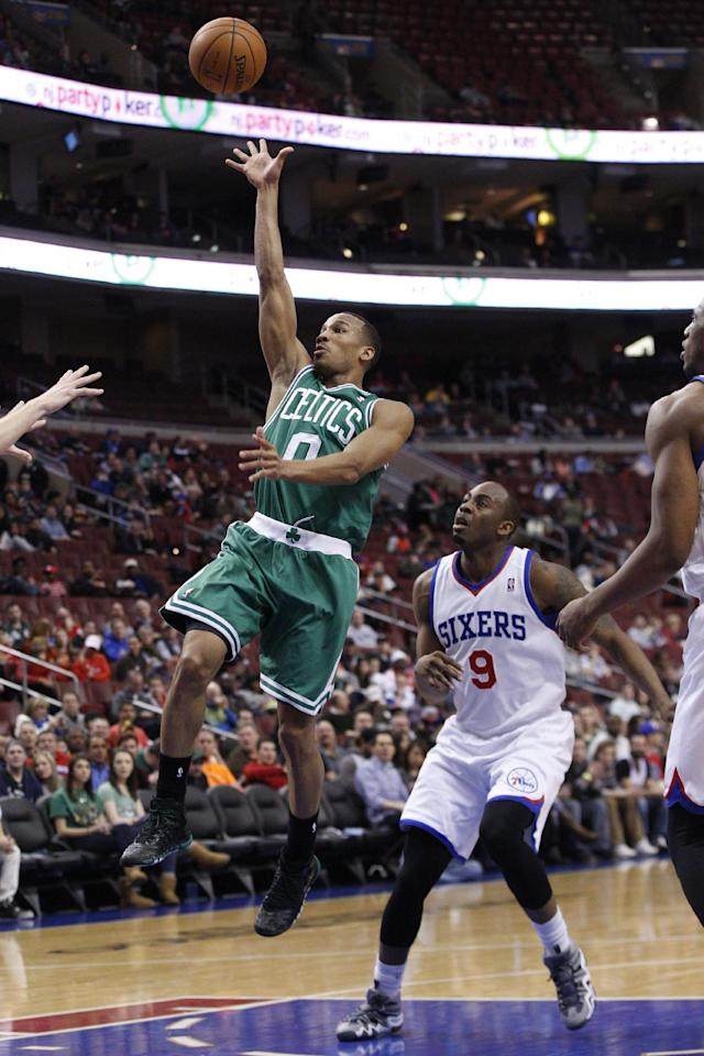 Boston Celtics' Avery Bradley, left, goes up for the shot as he gets past Philadelphia 76ers' James Anderson during the first half of an NBA basketball game, Wednesday, Feb. 5, 2014, in Philadelphia. (AP Photo/Chris Szagola)
