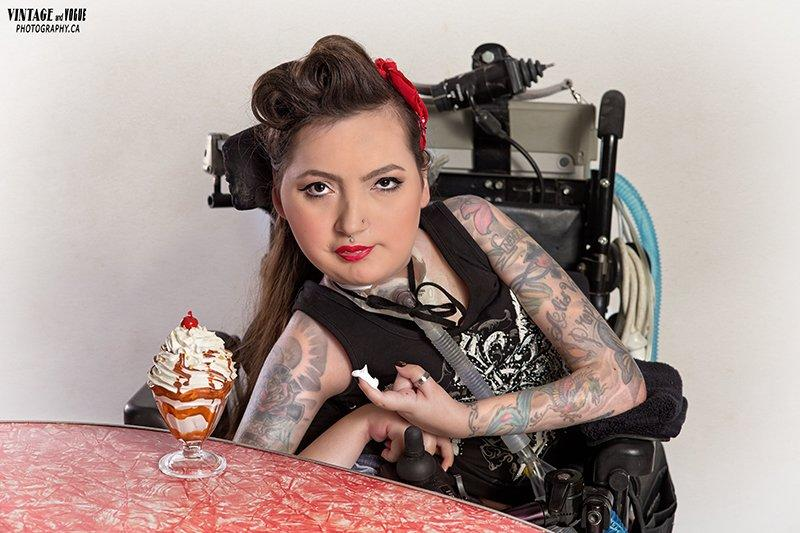 Crystal in pin-up attire, with an ice cream sundae next to her.