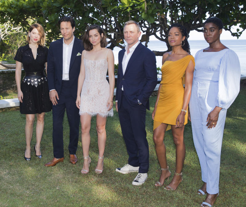 Actress Lea Seydoux, from left, director Cary Joji Fukunaga, actors Ana de Armas, Daniel Craig, Naomie Harris and Lashana Lynch pose for photographers during the photo call of the latest installment of the James Bond film franchise, currently known as 'Bond 25', in Oracabessa, Jamaica, Thursday, April 25, 2019. (AP Photo/Leo Hudson)