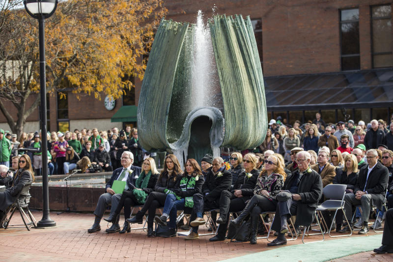 FILE - In this Nov. 14, 2019, file photo, Marshall University hosts its 49th annual Memorial Fountain Ceremony in Huntington, W.Va. Marshall and East Carolina will open the 2020 football season a week earlier to accommodate a national television broadcast to mark the 50th anniversary of the worst disaster in U.S. sports history. The schools were bonded forever when Marshall's chartered plane crashed while returning from a game at East Carolina on Nov. 14, 1970. (Sholten Singer/The Herald-Dispatch via AP, File)