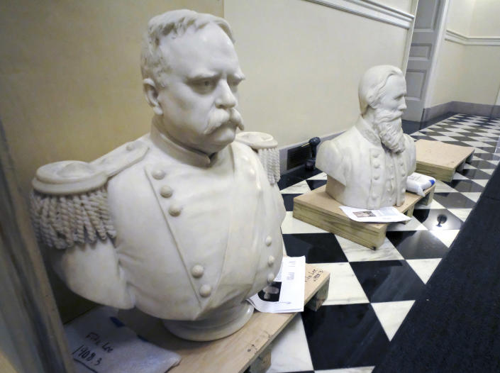 """Busts of Fitzhugh Lee, left, and James Ewell Brown """"Jeb"""" Stuart sit in a hallway inside the Virginia Capitol in Richmond on Thursday. (Bob Brown/Richmond Times-Dispatch via AP)"""
