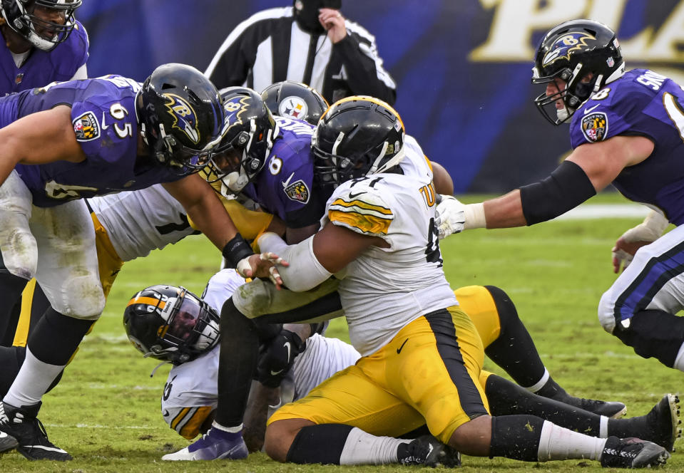 BALTIMORE, MD - NOVEMBER 01: Baltimore Ravens quarterback Lamar Jackson (8) is sacked by Pittsburgh Steelers defensive end Stephon Tuitt (91) during the Pittsburgh Steelers game versus the Baltimore Ravens on November 1, 2020 at M&T Bank Stadium in Baltimore, MD.  (Photo by Mark Goldman/Icon Sportswire via Getty Images)