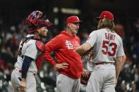 St. Louis Cardinals pitching coach Mike Maddux talks to John Gant and Yadier Molina during the third inning of a baseball game against the Milwaukee Brewers Wednesday, May 12, 2021, in Milwaukee. (AP Photo/Morry Gash)