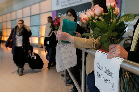 Opponents of U.S. President Donald Trump's executive order travel ban greet international travelers at Logan Airport in Boston, Massachusetts, U.S. February 3, 2017. REUTERS/Brian Snyder