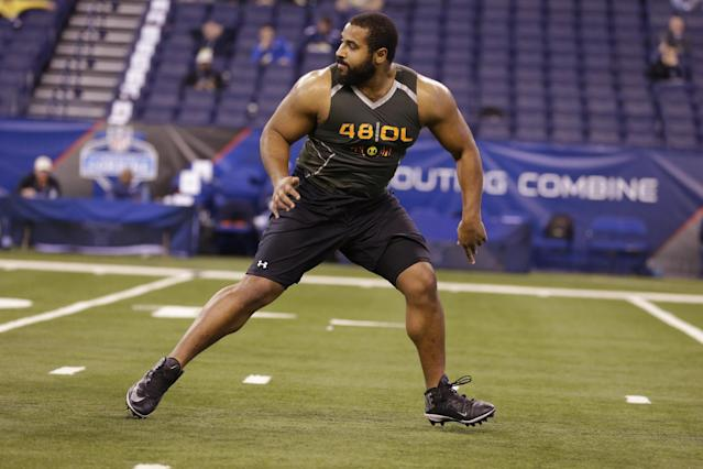 Penn State offensive lineman John Urschel runs a drill at the NFL football scouting combine in Indianapolis, Saturday, Feb. 22, 2014. (AP Photo/Michael Conroy)