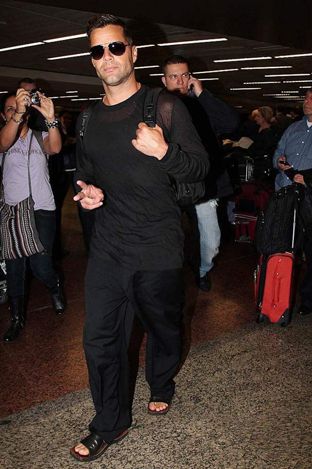 "Although Ricky Martin is known for ""Livin' La Vida Loca,"" he kept things peaceful when he landed at the Sao Paulo-Guarulhos International Airport in Brazil. Photo Rio News/<a href=""http://www.splashnewsonline.com"" target=""new"">Splash News</a> - August 25, 2011"