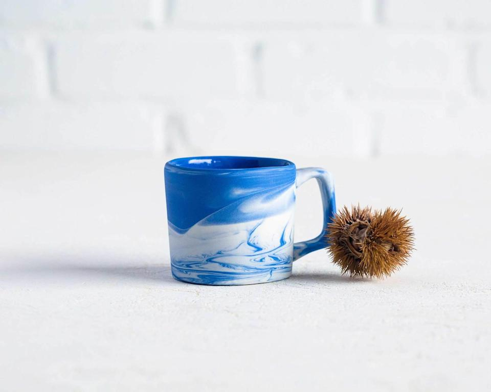 """<h2>Haand Cloudware Mug</h2><br>This North Carolina-based ceramics brand makes super-durable, restaurant-quality pottery with a hand-hewn feel. We love this marbled mug as a gift for a far-flung pal — they'll think of you every time they sip their wake-up beverage of choice. <br><br><em>Shop <strong><a href=""""https://haand.us/"""" rel=""""nofollow noopener"""" target=""""_blank"""" data-ylk=""""slk:Haand"""" class=""""link rapid-noclick-resp"""">Haand</a></strong></em><br><br><strong>Haand</strong> Cloudware Mug (Short), $, available at <a href=""""https://go.skimresources.com/?id=30283X879131&url=https%3A%2F%2Fhaand.us%2Fcollections%2Ffavorites%2Fproducts%2F8oz-cloudware-short-mug"""" rel=""""nofollow noopener"""" target=""""_blank"""" data-ylk=""""slk:Haand"""" class=""""link rapid-noclick-resp"""">Haand</a>"""