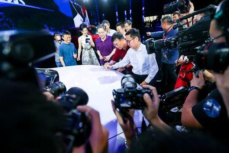 Jack Ma (L), Alibaba's founder and chairman, and other company leaders attend the launch event of a internet-connected car in Hangzhou, Zhejiang province, July 6, 2016. China Daily/via REUTERS