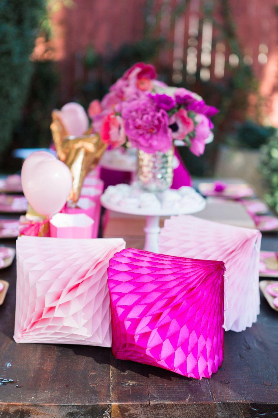 "<p>Rose-petal pink and hot pink honeycomb lanterns lend any vignette or Valentine's Day party a sense of lighthearted buoyancy. Pair with matching flowers to continue the color palette. </p><p><em>Via <a href=""http://www.twinkandsis.com/blog/2015/2/12/mommy-and-toddler-valentine-party"" rel=""nofollow noopener"" target=""_blank"" data-ylk=""slk:Marlan Willardson and Laurén LaRocca of Twink + Sis"" class=""link rapid-noclick-resp"">Marlan Willardson and Laurén LaRocca of Twink + Sis</a></em></p><p><a class=""link rapid-noclick-resp"" href=""https://go.redirectingat.com?id=74968X1596630&url=https%3A%2F%2Fwww.etsy.com%2Flisting%2F493054684%2Fheart-shaped-honeycomb-decoration%3Fgpla%3D1%26gao%3D1%26gclid%3DCjwKCAiA9vOABhBfEiwATCi7GHle7l_4079UkQE5ix391w9XqiqMEKXJzm87-3cVeTzT5cfND-JAcBoCi-oQAvD_BwE&sref=https%3A%2F%2Fwww.elledecor.com%2Flife-culture%2Ffun-at-home%2Fg2387%2Fvalentines-day-decor%2F"" rel=""nofollow noopener"" target=""_blank"" data-ylk=""slk:GET THE LOOK"">GET THE LOOK</a><em><br>Heart-Shaped Honeycomb Decoration, Etsy, $10.33</em></p>"