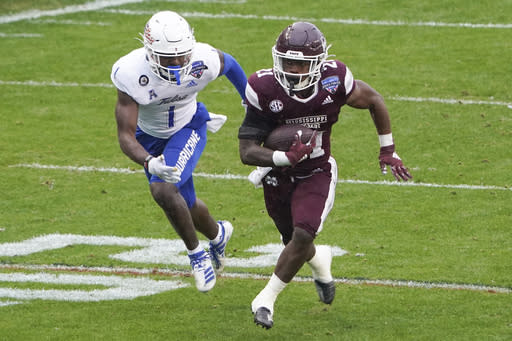 Mississippi State running back Jo'Quavious Marks (21) runs past Tulsa safety Kendarin Ray (1) for a touchdown during the first half of the Armed Forces Bowl NCAA college football game Thursday, Dec. 31, 2020, in Fort Worth, Texas. (AP Photo/Jim Cowsert)