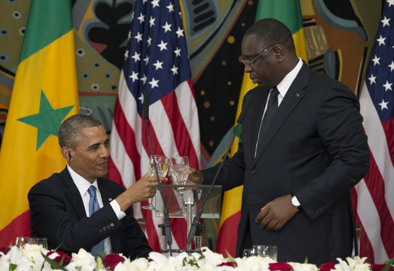 U.S. President Barack Obama, left, and Senegalese President Macky Sall toast during an official dinner at the Presidential Palace on Thursday, June 27, 2013, in Dakar, Senegal. Obama is visiting Senegal, South Africa, and Tanzania on a week long trip. (AP Photo/Evan Vucci)