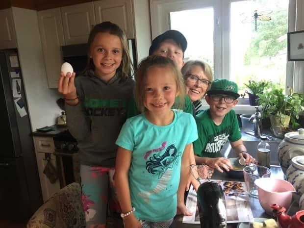 Marley Waiser and four of her grandchildren tackle a baking project.