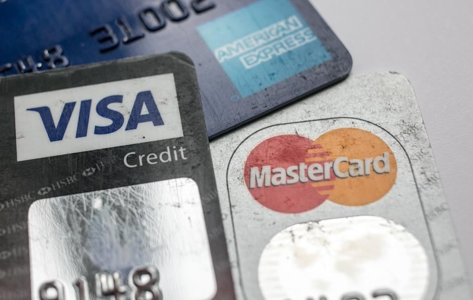 BRISTOL, ENGLAND - NOVEMBER 03:  In this photo illustration credit debit cards are seen on November 3, 2017 in Bristol, England. The Bank of England raised interest rates from a historic low for the first time in ten years this week raising costs of lending and concerns for householder debt.  (Photo by Matt Cardy/Getty Images)