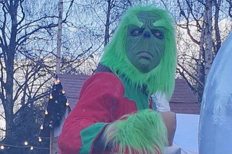 Visitors to the drive-through are greeted by a Grinch described by one parent as 'the stuff of nightmares'. (Reach)