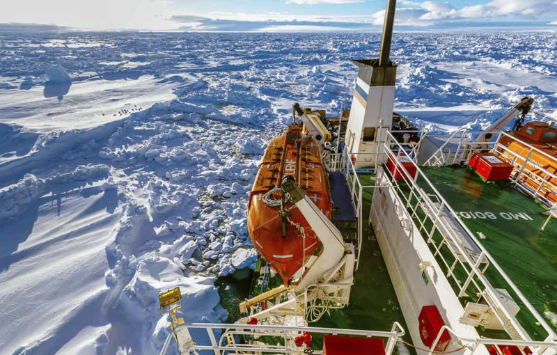 In this image provided by Australasian Antarctic Expedition/Footloose Fotography, Russian ship MV Akademik Shokalskiy is trapped in thick Antarctic ice, 1,500 nautical miles south of Hobart, Australia, Friday, Dec. 27, 2013. The research ship, with 74 scientists, tourists and crew on board, has been on a research expedition to Antarctica, when it got stuck Tuesday after a blizzard's whipping winds pushed the sea ice around the ship, freezing it in place. (AP Photo/Australasian Antarctic Expedition/Footloose Fotography, Andrew Peacock) EDITORIAL USE ONLY