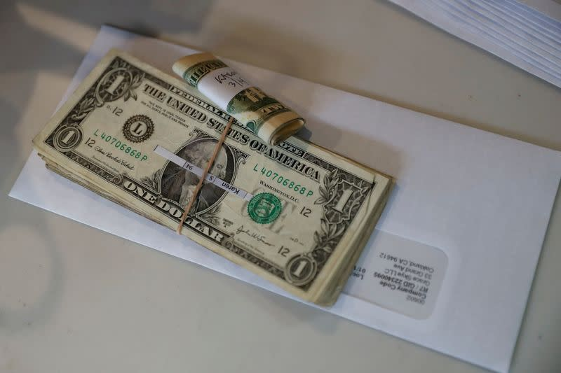 FILE PHOTO: Tips, money collected from a customer donation fund and a last paycheck for employees laid off from Farley's East cafe, that closed due to the financial crisis caused by the coronavirus disease (COVID-19), sits on a counter at the cafe in Oak