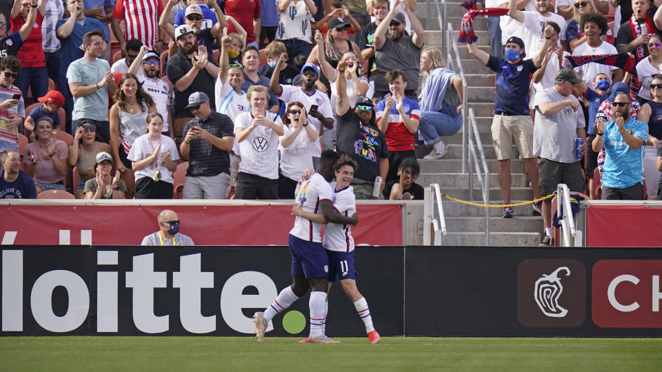 United States' Daryl Dike (24) receives a hug from Brenden Aaronson (11) after scoring against Costa Rica during the first half during an international friendly soccer match Wednesday, June 9, 2021, in Sandy, Utah. (AP Photo/Rick Bowmer)