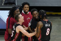 Miami Heat center Bam Adebayo, second from right, is mobbed by teammates after he made the winning shot against the Brooklyn Nets at the end of an NBA basketball game, Sunday, April 18, 2021, in Miami. (AP Photo/Wilfredo Lee)