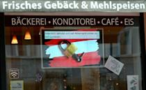 "A sign reading ""Austria in lockdown since midnight"" hangs in the window of a closed bakery shop"