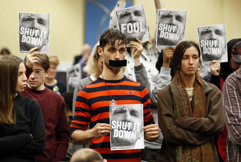 FILE - In this Jan. 8, 2019, file photo, protesters hold signs as they turn their backs on a meeting of the Virginia State Air Quality Control Board in Richmond, Va. The U.S. Supreme Court is set to wade into a long-running battle between developers of a 605-mile natural gas pipeline and environmental groups who oppose the pipeline crossing the storied Appalachian Trail. On Monday, Feb. 24, 2020, the high court will hear arguments on a critical permit needed by developers of the Atlantic Coast Pipeline. (AP Photo/Steve Helber, File)