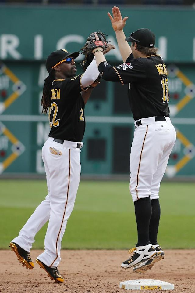Pittsburgh Pirates' Andrew McCutchen (22) celebrates with Neil Walker after getting the final out of a 3-1 win over the St. Louis Cardinals in a baseball game in Pittsburgh Wednesday, Aug. 27, 2014. (AP Photo/Gene J. Puskar)