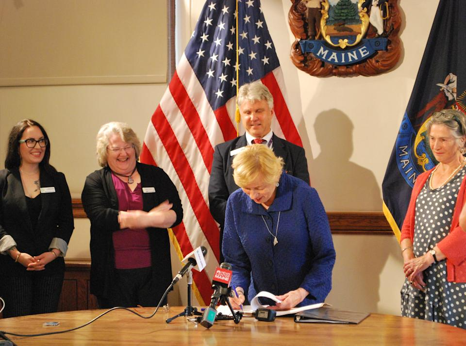 Governor Mills signs a student loan bill of rights. (Source: The office of Governor Mills)