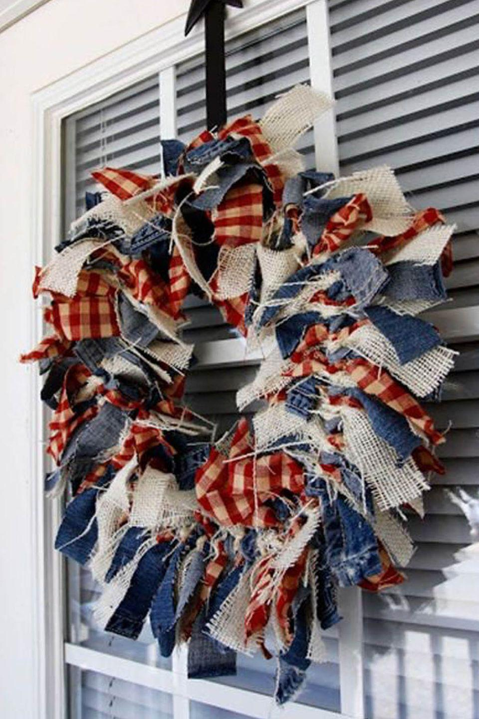 """<p>Upcycle an old pair of jeans, then add strips of burlap and gingham, to make this shabby-chic wreath. </p><p><strong>Get the tutorial at <a href=""""http://notjustbrides.blogspot.com/2012/06/independence-day-craft-4th-of-july-rag.html"""" rel=""""nofollow noopener"""" target=""""_blank"""" data-ylk=""""slk:Beyond the Aisle"""" class=""""link rapid-noclick-resp"""">Beyond the Aisle</a>. </strong></p><p><strong><a class=""""link rapid-noclick-resp"""" href=""""https://www.amazon.com/Wired-Burlap-Ribbon-American-Stars/dp/B071S2H25P/ref=sr_1_2?tag=syn-yahoo-20&ascsubtag=%5Bartid%7C10050.g.4464%5Bsrc%7Cyahoo-us"""" rel=""""nofollow noopener"""" target=""""_blank"""" data-ylk=""""slk:SHOP PATRIOTIC BURLAP RIBBON"""">SHOP PATRIOTIC BURLAP RIBBON </a></strong></p>"""