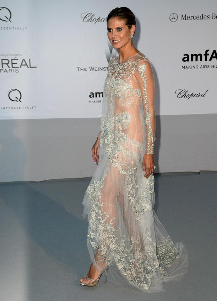 Heidi Klum is never afraid to wear a daring dress. This summer, the golden girl of the Golden Globes wore a transparent creation at the Cannes Film Festival this year.