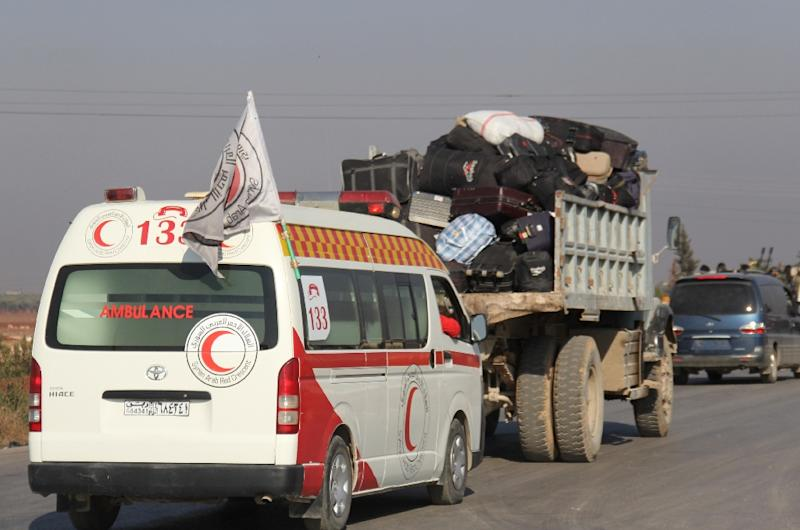 A convoy of Syrian Red Crescent ambulances transporting wounded civilians and rebels from the villages of Fuaa and Kafraya heads towards the Cilvegozu crossing with Turkey on December 28, 2015 (AFP Photo/Omar Haj Kadour)