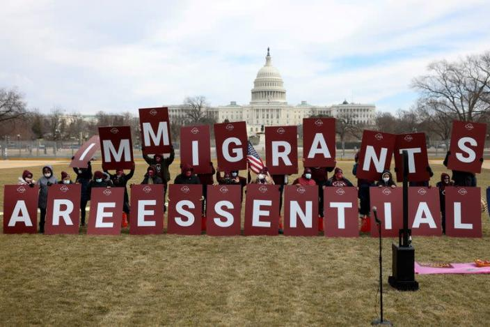 FILE PHOTO: Immigrant essential workers rally near the U.S. Capitol in Washington