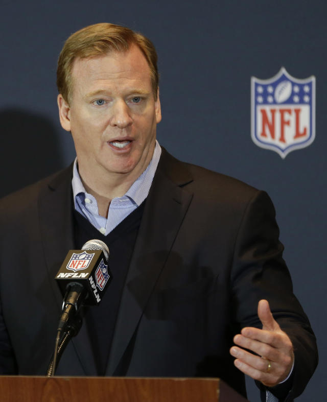 FILE - In this March 26, 2014, file photo, NFL Commissioner Roger Goodell answers questions during a news conference at the NFL football annual meeting in Orlando, Fla. Goodell told a gathering of Associated Press Sports Editors on Thursday, April 24, 2014, that a vote is uncertain on the proposal to add two teams to the postseason. (AP Photo/John Raoux, File)