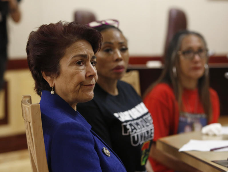 State Sen. Anna Caballero, D-Salinas, left, listens as members of the Senate Public Safety Committee discusses her police-backed law enforcement training bill during a hearing at the Capitol Tuesday, April 23, 2019, in Sacramento, Calif. Lawmakers worked to find common ground between law enforcement organizations, which support Caballero's bill and reformers supporting a competing measure, by Democratic Assemblywoman Shirley Weber, that would adopt the first-in-the-nation standards designed to limit fatal shootings by police. (AP Photo/Rich Pedroncelli)