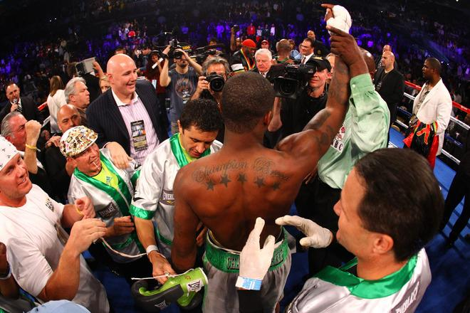 ATLANTIC CITY, NJ - APRIL 28:  Chad Dawson celebrates with his corner after he was the declared the winner after a 12 round decision against Bernard Hopkins during their WBC & Ring Magazine Light Heavyweight Title fight at Boardwalk Hall Arena on April 28, 2012 in Atlantic City, New Jersey.  (Photo by Al Bello/Getty Images)