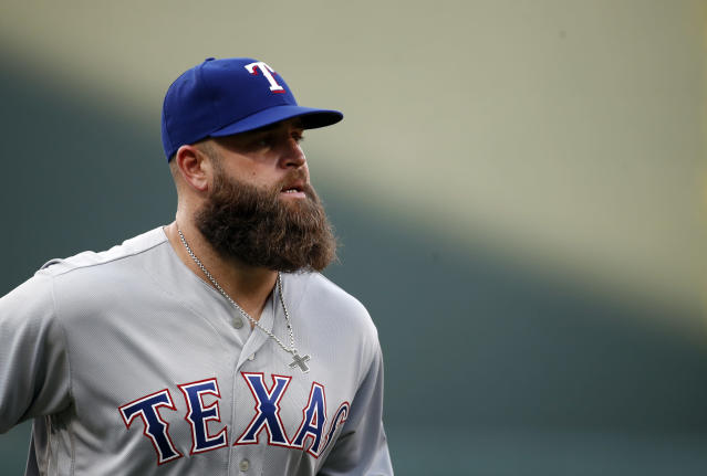 Texas' Mike Napoli walks on the field before a game against the Baltimore Orioles on July 18. (AP)