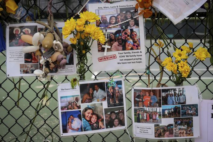 FILE - In this Tuesday, July 6, 2021, file photo, a memorial for the Guara family is posted on a fence near the Champlain Towers South, in Surfside, Fla. Recovery crews at the Florida condominium collapse are cataloging all personal possessions found in the rubble in hopes of returning them to families of the dead or survivors. (Carl Juste/Miami Herald via AP, File)
