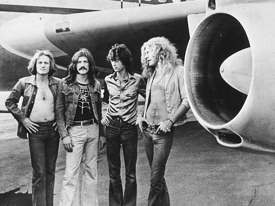 <p>John Paul Jones, John Bonham (1948 to 1980), Jimmy Page and Robert Plant in front of their private airliner, The Starship, 1973</p> (Getty Images)