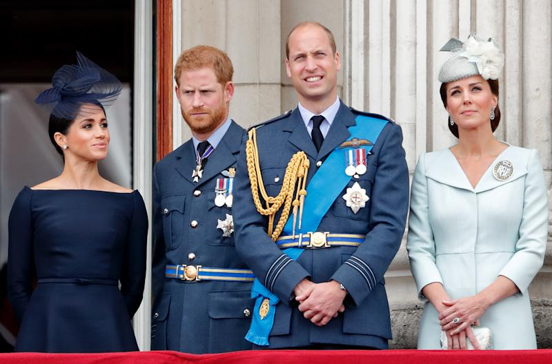 Meghan, Duchess of Sussex, Prince Harry, Duke of Sussex, Prince William, Duke of Cambridge and Catherine, Duchess of Cambridge watch a flypast to mark the centenary of the Royal Air Force from the balcony of Buckingham Palace on July 10, 2018 in London, England. The 100th birthday of the RAF, which was founded on on 1 April 1918, was marked with a centenary parade with the presentation of a new Queen's Colour and flypast of 100 aircraft over Buckingham Palace. (Photo by Max Mumby/Indigo/Getty Images)