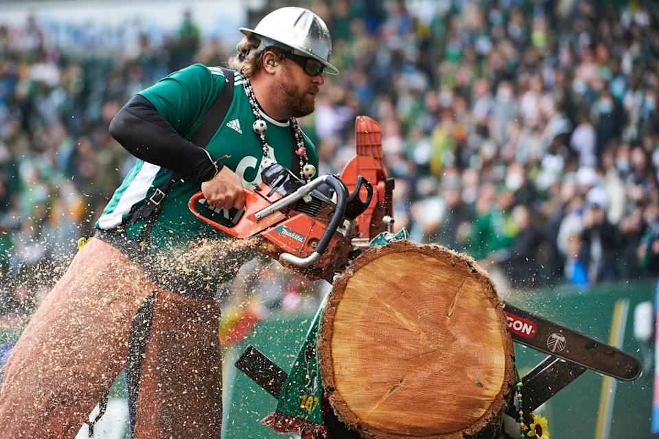 Timbers Joey uses a chainsaw to cut into a log after a Timbers goal during a 2-1 win against Los Angeles FC at Providence Park on Sunday.