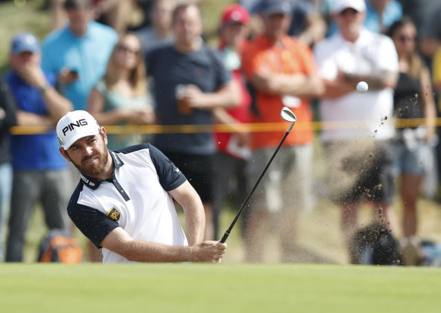 FILE - In this Saturday July 21, 2018 file photo, Louis Oosthuizen of South Africa plays out of a bunker on the 8th hole during the third round of the British Open Golf Championship in Carnoustie, Scotland. Louis Oosthuizen, the 2010 British Open champion, led the South African Open by a shot after a 9-under 62 in the first round on Thursday, Dec. 6. Oosthuizen, playing his home Open for the first time in eight years, made a brilliant start at Randburg Golf Club in Johannesburg with nine birdies, including six in an eight-hole surge on the back nine, and no bogeys. (AP Photo/Alastair Grant, file)