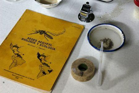 A book about Aedes aegypti mosquito is seen next to larvae in a laboratory conducting research on preventing the spread of the Zika virus and other mosquito-borne diseases, at the entomology department of the Ministry of Public Health in Guatemala City, February 4, 2016. REUTERS/Josue Decavele