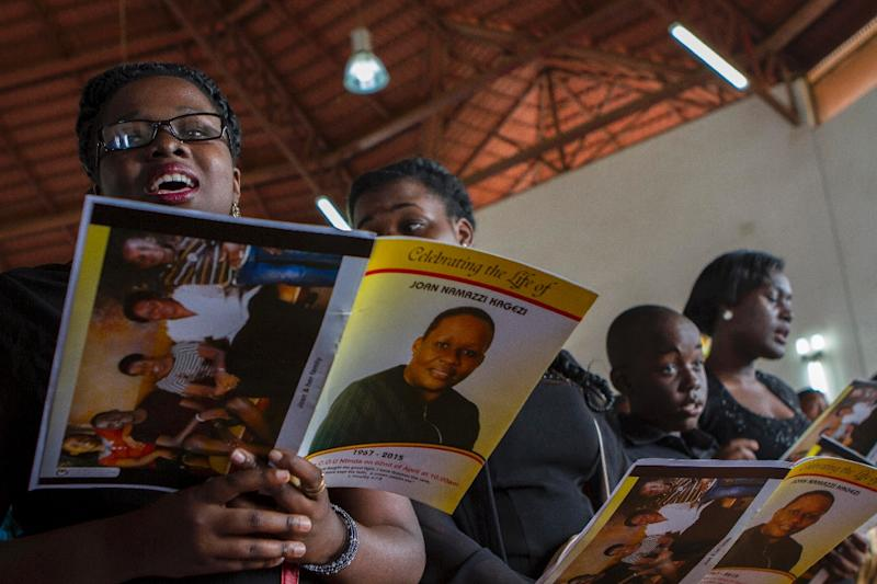 Children of the late acting assistant director of public prosecution Joan Kagezi attend a church service for their mother on April 2, 2015 in Kampala (AFP Photo/Isaac Kasamani)