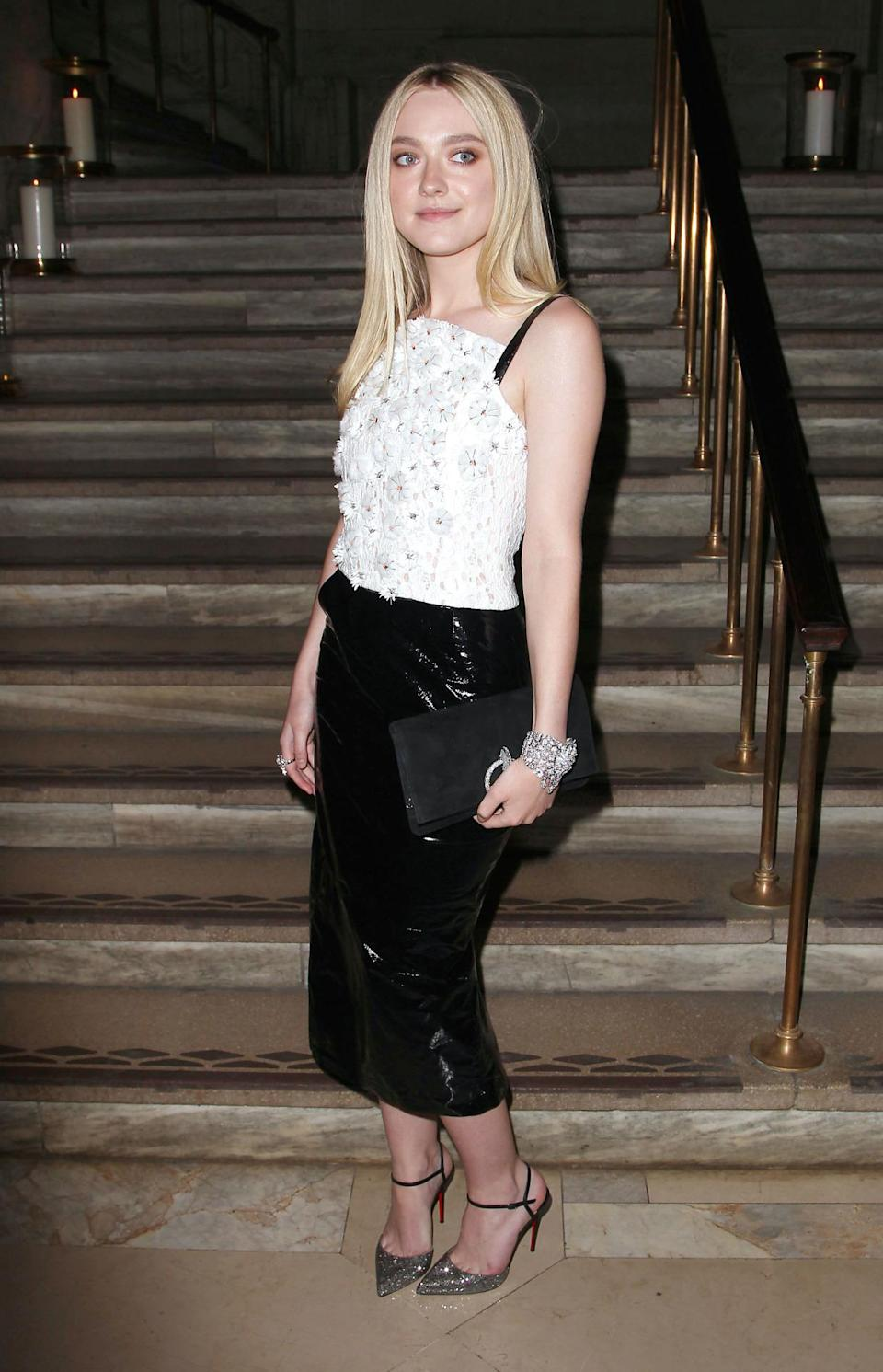 <p>Dakota went for a edgier look than normal in this patent skirt but we think she rocks it. Especially as it still had a feminine touch with the daisy detailed top.<i> [Photo: Rex Features]</i> </p>