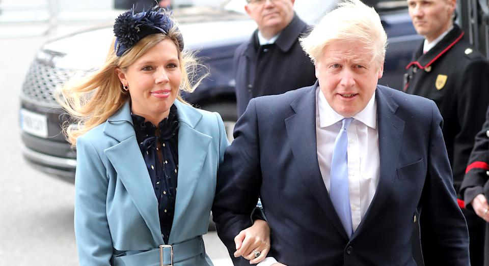 Carrie Symonds wears blue coat and dress to Commonwealth Service